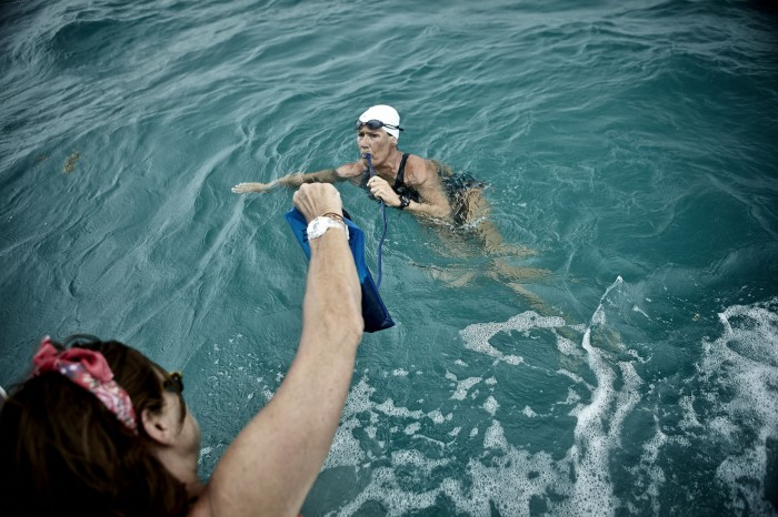 Bonnies hands over a feeding tube Nyad while she was training for her fourth attempt.  During the swim Nyad could not touch the boat or the swim would be ruled invalid.